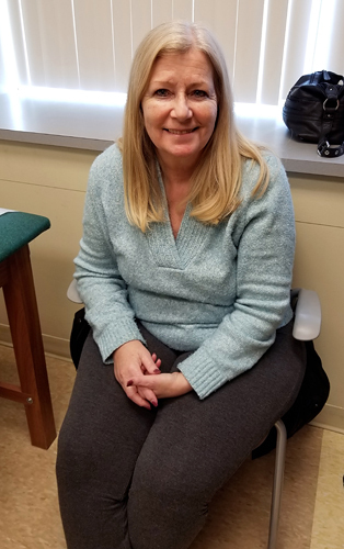 Cynthia, a patient of Dr. Janet Conway, smiling after treatment for bone infection