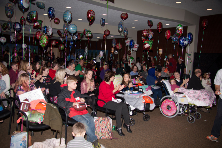 Families, volunteers and staff gather to celebrate at the International Center for Limb Lengthening pediatric holiday party