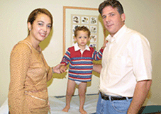 Happy parents with their child who has clubfoot