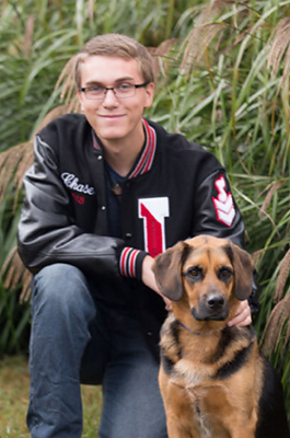 Chase in his varsity jacket with his dog
