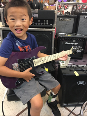 Primo playing electric guitar