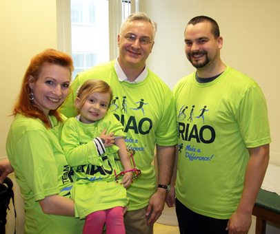Anicka wearing an ex fix with her parents and Dr. Shawn Standard wearing Team RIAO (Rubin Institute for Advanced Orthopedics) T-shirts