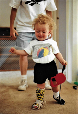 Christopher as toddler walking with cast