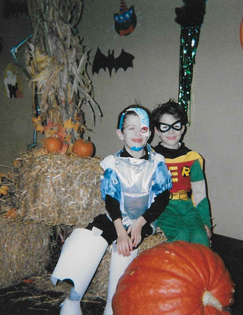 Christopher as a young boy in cyborg Halloween costume wearing ex fix cover with his twin