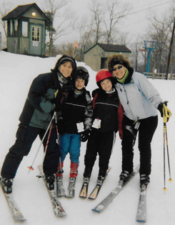 Christopher with his family skiing