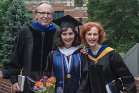 Katia with her parents at her college graduation
