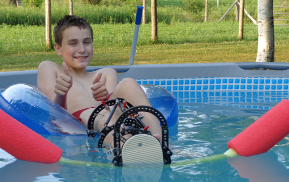 Chase in the pool with an external fixator from his first surgery at the International Center for Limb Lengthening