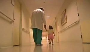 Dr. John Herzenberg walking with a clubfoot patient in the International Center for Limb Lengthening clinic