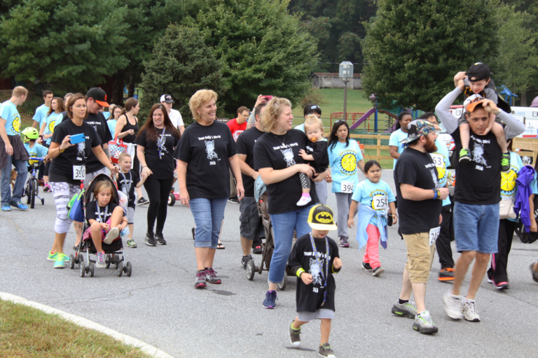 "Multiple participants of all ages walking in the ""Make a Difference Walk"" at Rubin Institute for Advanced Orthopedics 2016 Save-A-Limb Fund Event"