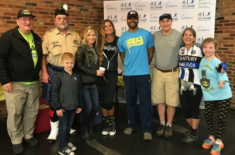 Dr. John Herzenberg, news anchor Jessica Kartalija, Pediatric Liaison Marilyn Richardson, Survivor: Fiji reality television winner and founder of Perthes Kids Foundation Earl Cole, and Dr. Shawn Standard pose with patients and volunteers at Rubin Institute for Advanced Orthopedics 2017 Save-A-Limb Fund Event