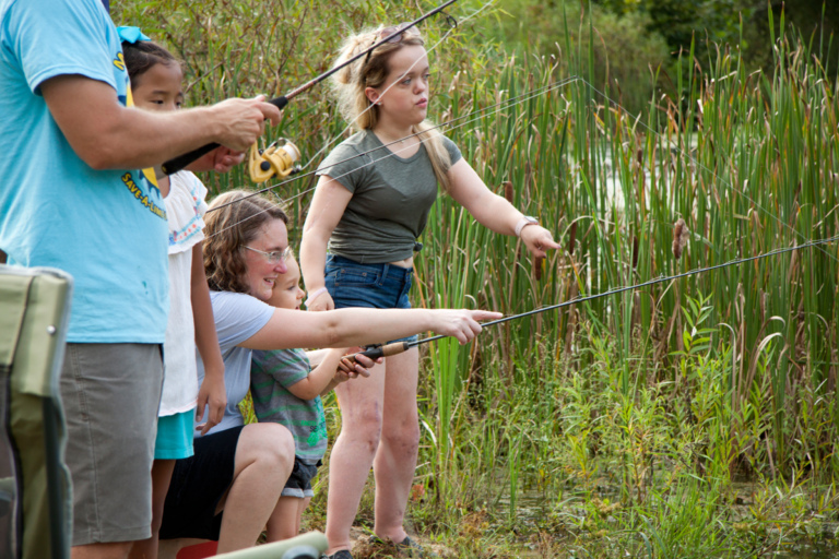 Patients and parents fishing at pond during Rubin Institute for Advanced Orthopedics 2018 Save-A-Limb Pool Party event