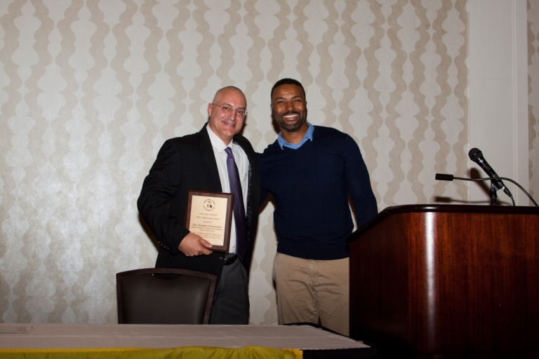 Earl Cole, Survivor: Fiji reality television winner and founder of the Perthes Kids Foundation, presents an award to Dr. Shawn Standard at Rubin Institute for Advanced Orthopedics 2017 Save-A-Limb Fund Dinner