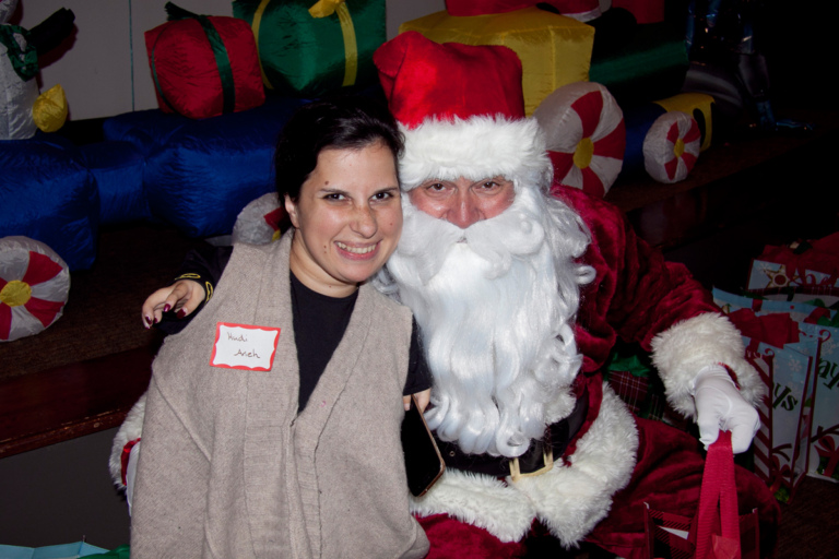 Santa and young woman patient at the International Center for Limb Lengthening pediatric holiday party