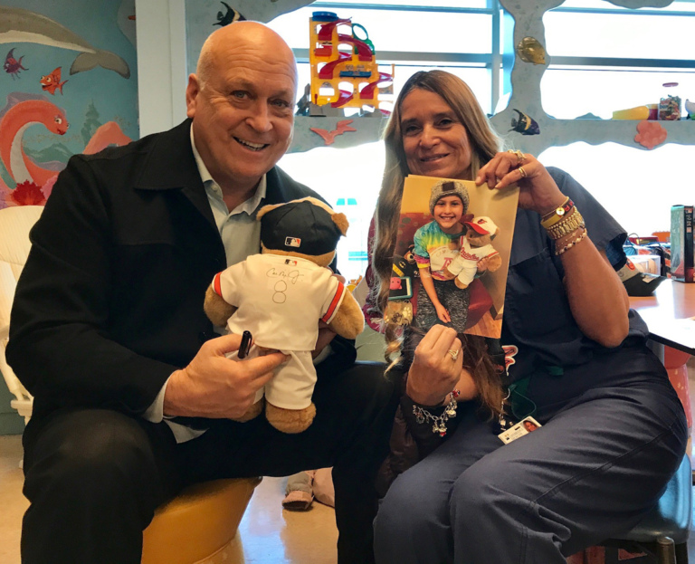 Marilyn Richardson, Pediatric Liaison and Cal Ripken pose for picture while holding autographed Baltimore Orioles teddy bear and patient picture at Herman & Walter Samuelson Children