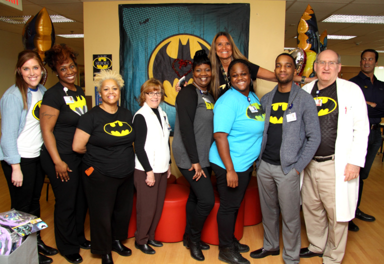 "Dr. John Herzenberg and 8 staff members of the International Center for Limb Lengthening show off their Batman shirts at the International Center for Limb Lengthening's Leonard B. ""Batman"" Robinson Memorial Valentine's Day Party"