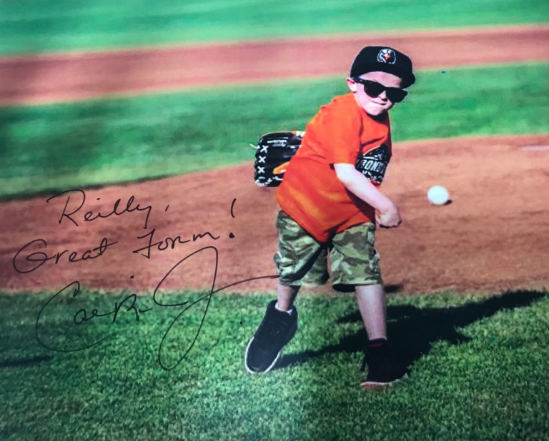 Cal Ripken autographed picture of young boy patient throwing baseball