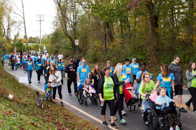Families, patients walking and in wheelchairs and other participants walking during the family fun walk at Rubin Institute for Advanced Orthopedics 2017 Save-A-Limb Fund Event