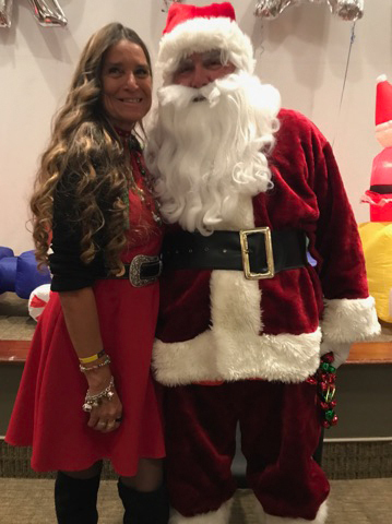 Pediatric Liaison Marilyn Richardson poses with Santa at the International Center for Limb Lengthening pediatric holiday party