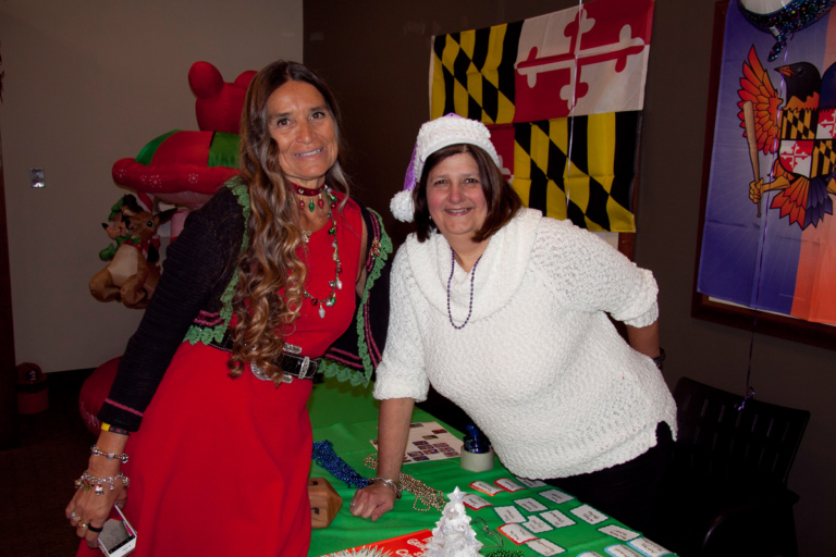 Pediatric Liaison Marilyn Richardson poses for a picture with a female volunteer at the International Center for Limb Lengthening pediatric holiday party