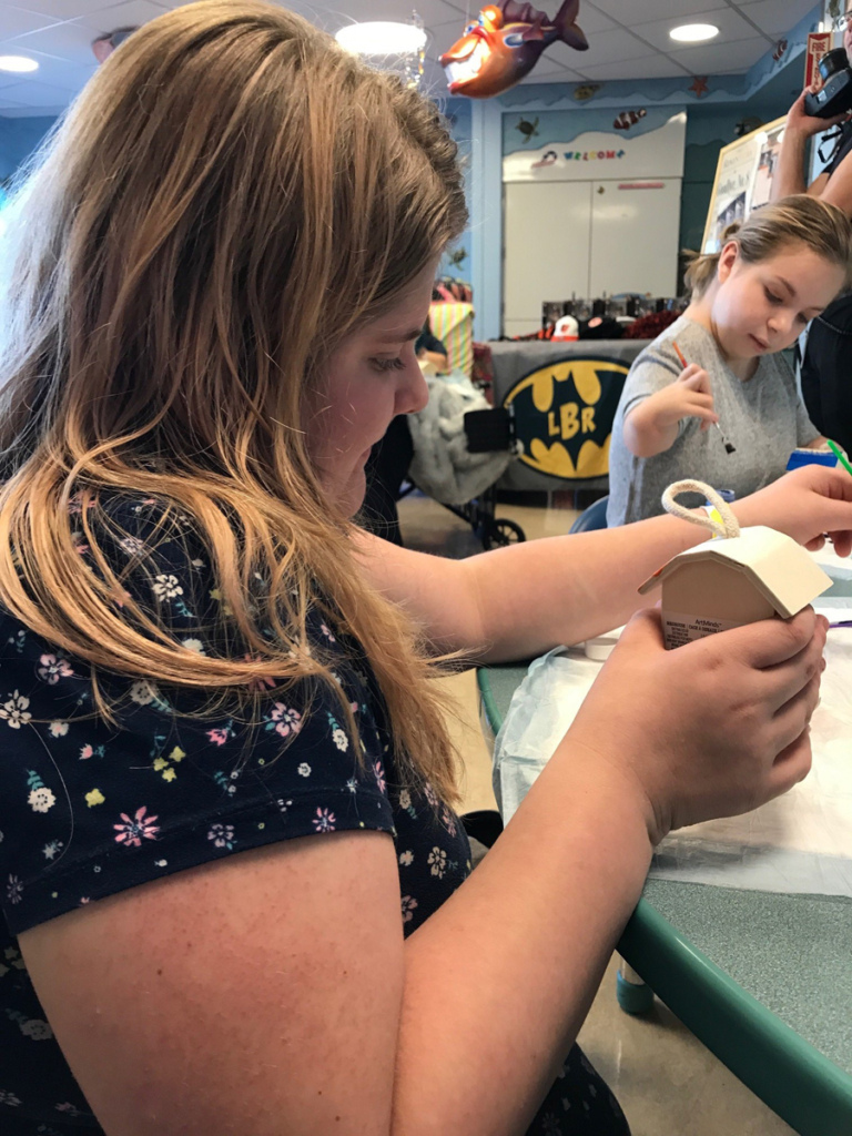 2 girl patients paint birdhouses at Cal Ripken at Herman & Walter Samuelson Children