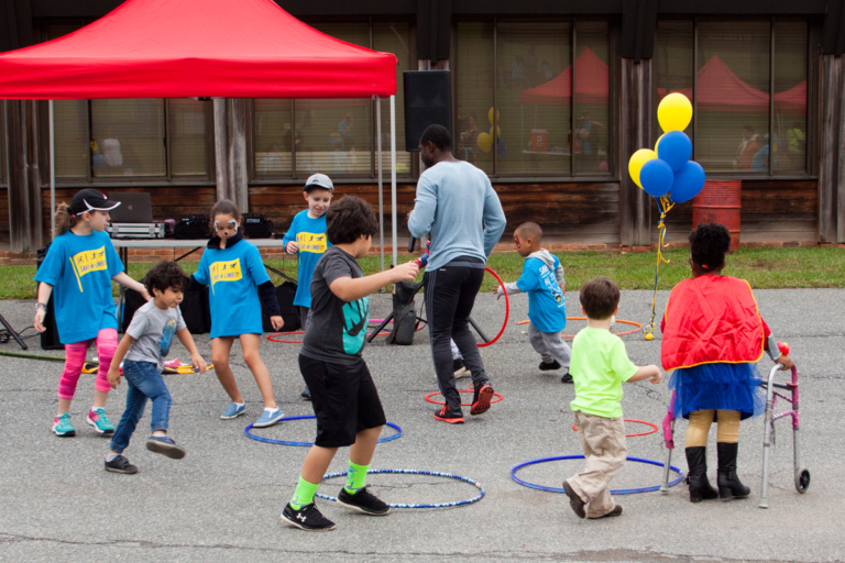 Young children play with hula hoops at Rubin Institute for Advanced Orthopedics 2017 Save-A-Limb Fund Event