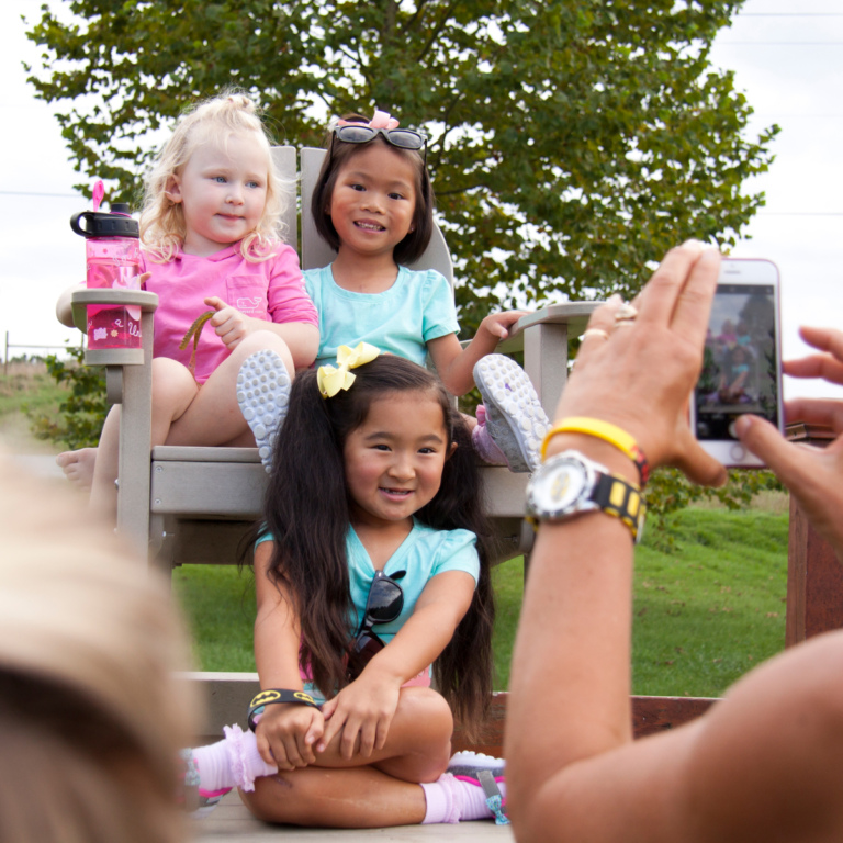 3 young girls having their picture taken outside during Rubin Institute for Advanced Orthopedics 2018 Save-A-Limb Pool Party event