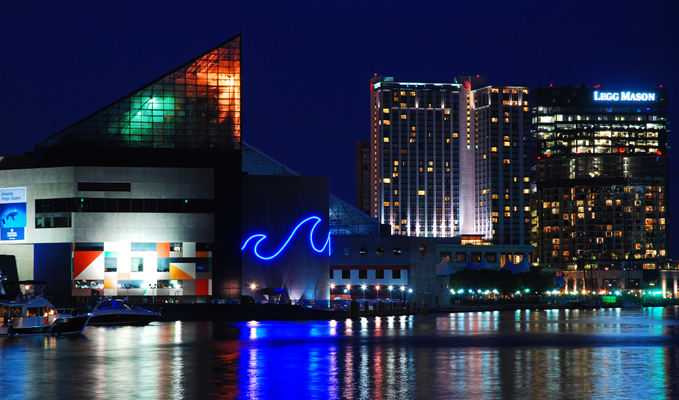 Baltimore's Inner Harbor at night, including the National Aquarium and the Legg Mason Tower