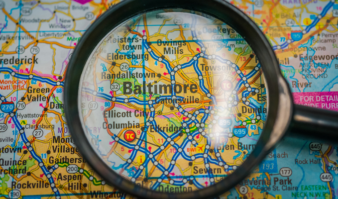 Magnifying glass on a map of Baltimore, Maryland