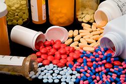Pills spilling out of medication bottles