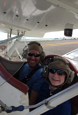 Gary and his father in a biplane