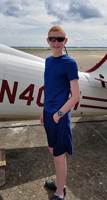 Gary standing next to a biplane
