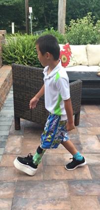 Primo walking wearing shoe lift