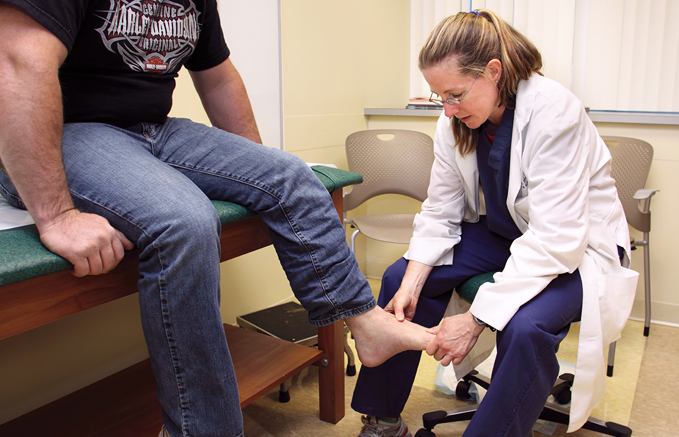 Dr. Janet Conway examining a patient's foot at the International Center for Limb Lengthening