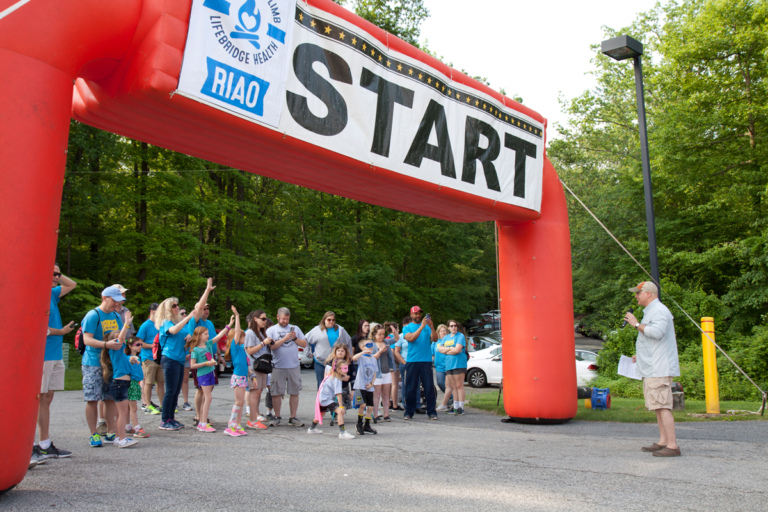 Dr. Shawn Standard addressing Camp Save-A-Limb participants at the Lenny B. Robinson Make A Difference Walk start gate