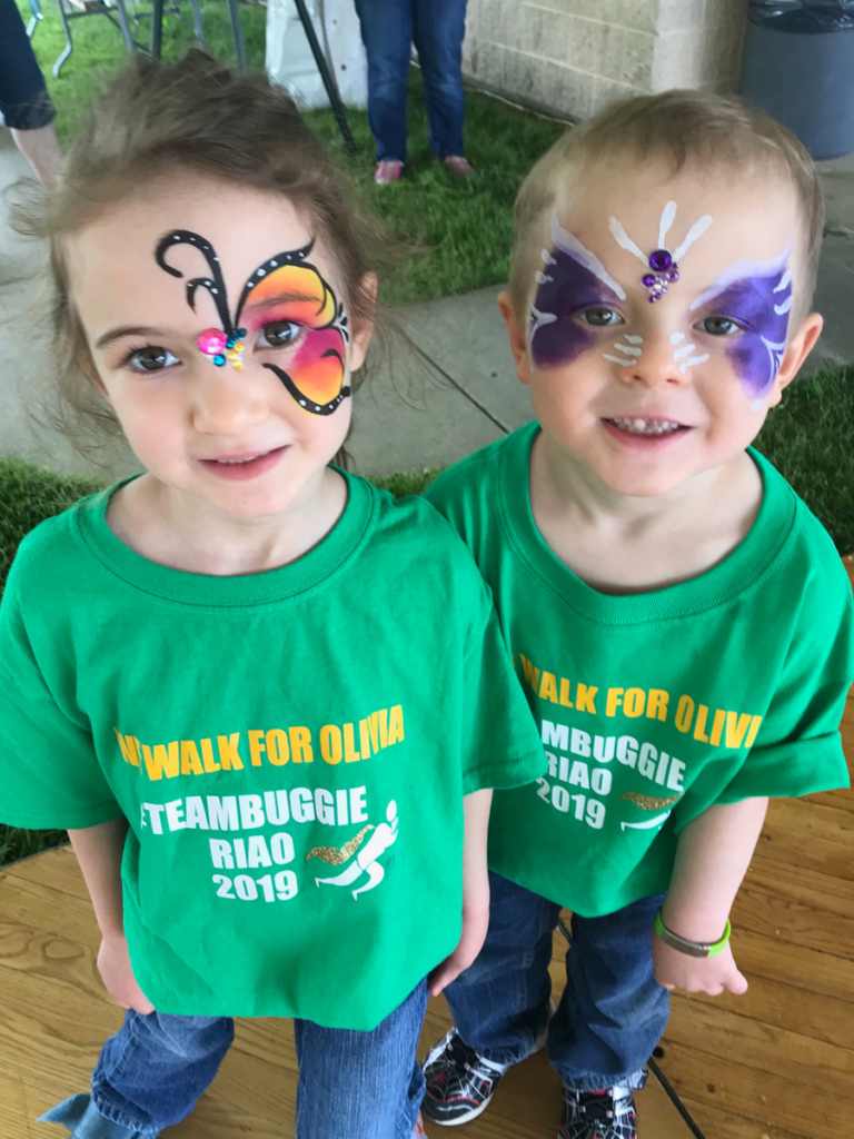 2 young siblings wearing face make up and matching patient team t-shirts