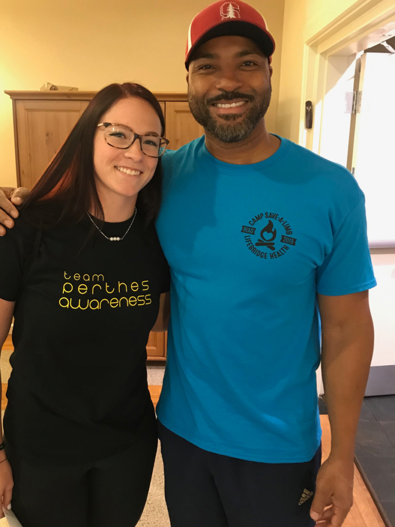 "Earl Cole, ""Survivor: Fiji"" winner and Perthes Kids Foundation founder with a patient in a Team Perthes Awareness t-shirt"