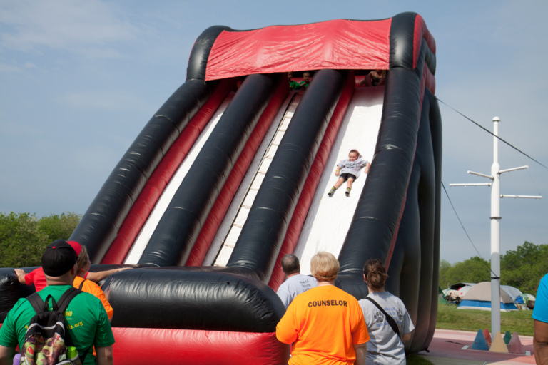 Giant inflatable slide with one child sliding down