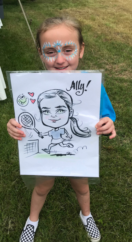 A young patient holding up a caricature of herself playing tennis