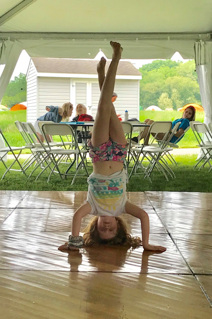 A young girl patient doing a handstand