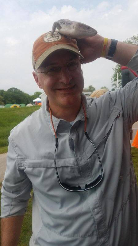 Dr. Shawn Standard with a lizard from the petting zoo on his hat