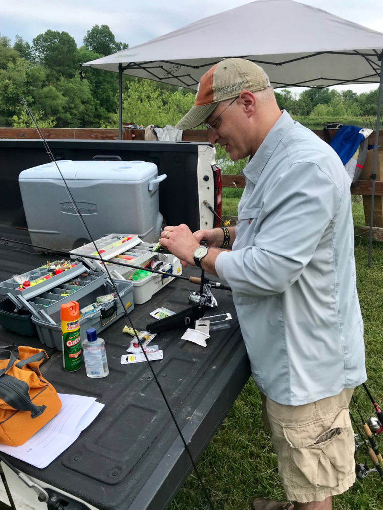Dr. Shawn Standard and his tackle boxes in the back of his truck