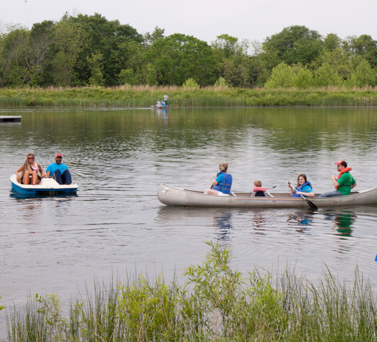 Staff and participants paddle boating and canoeing
