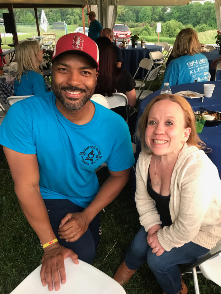 "Earl Cole, ""Survivor: Fiji"" winner smiling with a woman who was a former patient at the dinner"