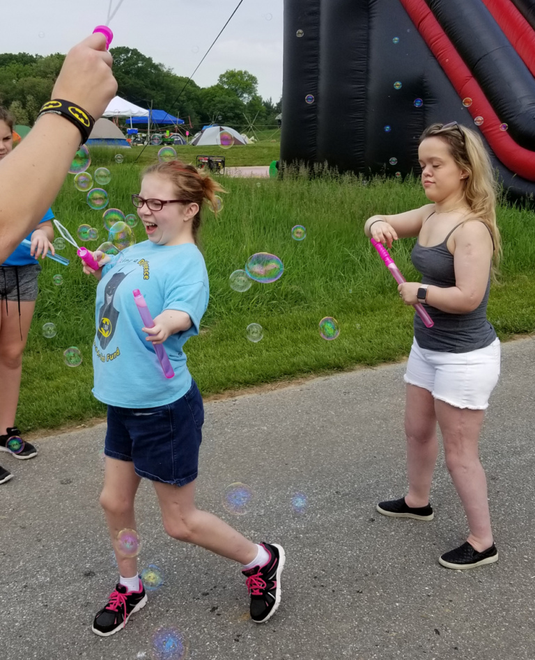 2 patients making bubbles with bubble wands