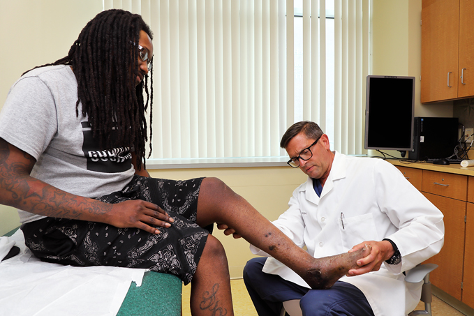Dr. Christopher Bibbo examining a patient's foot at the International Center for Limb Lengthening