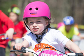 Charlotte riding in an hour bike ride for children