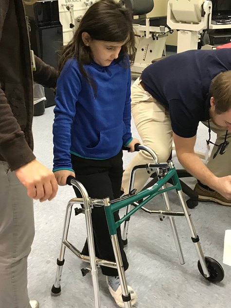 Gracie learning to use a walker