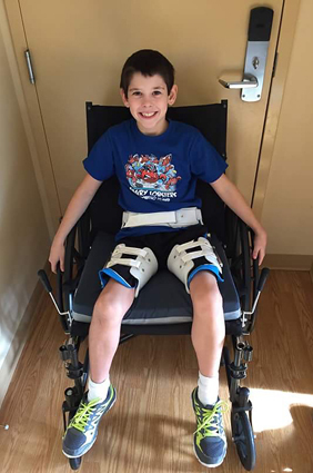 Jackson in a wheelchair during treatment