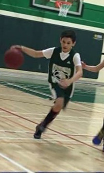 Jackson running while dribbling a basketball on the court post-treatment