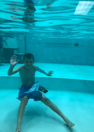 Preston wearing an external fixator while playing around underwater in the hydrotherapy pool